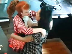 Redhead and Brown-haired Slurp And Play On Kitchen Counter