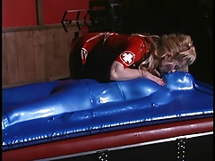 Blondie  decorates superslut in blue latex