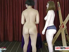 2 nymphs play a undress game of spin the dice