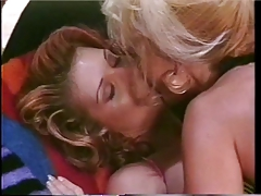 Platinum-blonde and red-head have joy with strap-on