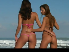 2 scorching beach honeys in micro bathing suit getting