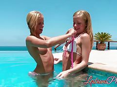 Beautiful youthfull lezzies  vulvas at an outdoor pool